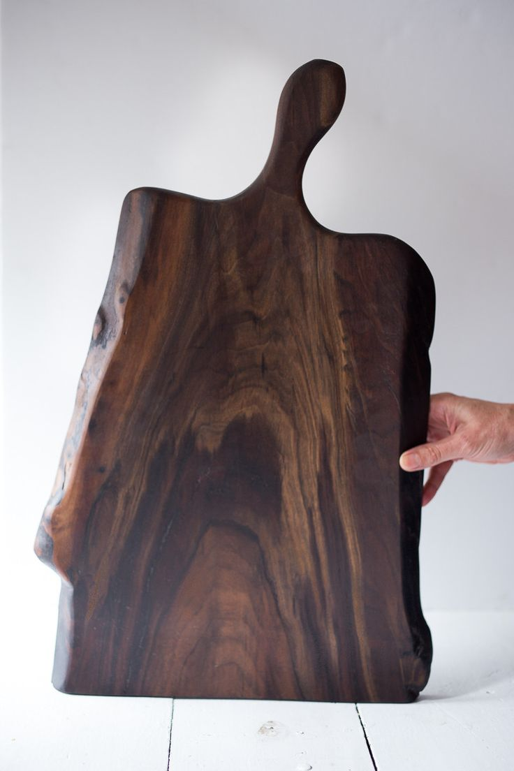 Add a warm touch of black walnut and serve your guests charcuterie, cheeses or any tasty delight on this beautiful board... These walnut boards were salvaged from a Spokane windstorm. They are nice an