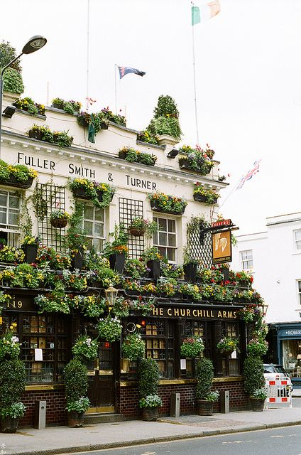 Churchill Arms, famous pub in Kensington, London, England. Built in 1750.