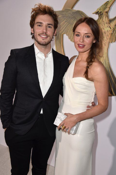 Laura Haddock and Sam Claflin at event of The Hunger Games: Mockingjay - Part 1 (2014)