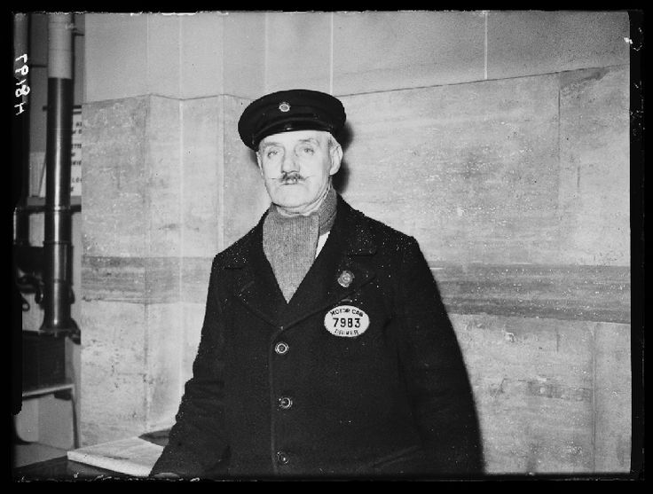 A photograph of J W Simmons, a London taxi driver, taken in January 1940 by George W Roper for the Daily Herald.