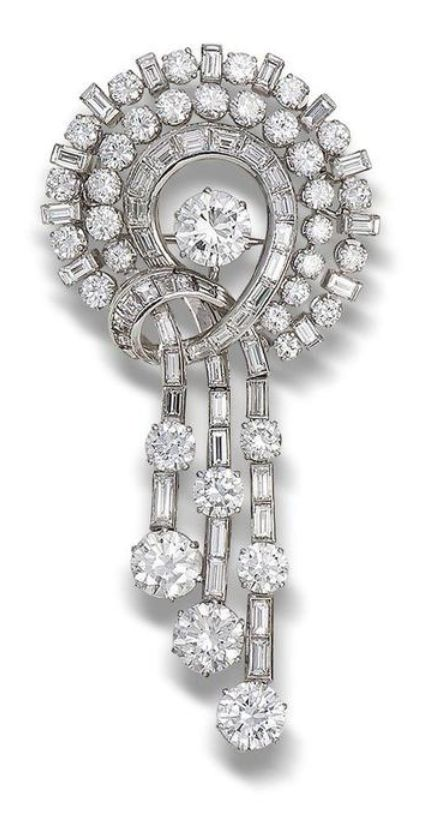 A diamond brooch, circa 1955. The three strands of brilliant and baguette-cut diamonds arranged in the form of a knot and tassel, around a central brilliant-cut diamond, principal diamonds weighing 1.40, 1.26, 1.20 and 0.98 carats, remaining brilliant-cut diamonds weighing approximately 4.50 carats total, baguette-cut diamonds weighing approximately 4.00 carats total, length 7.0cm.