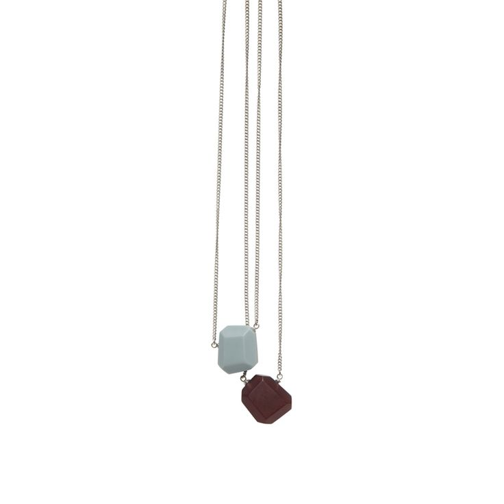 Add a touch of charm to any outfit with our fine, double pendant made from smooth, matte finish resin. Each pendant is on a separate chain so you can wear one or two at a time. Available in three colour combinations.