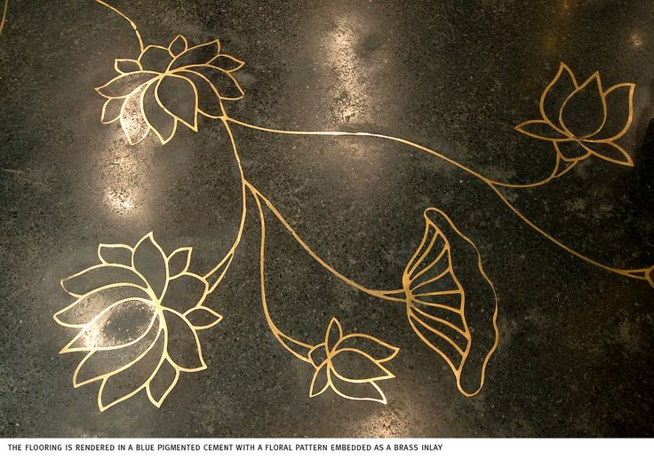 I love the creative opportunities you have h Terrazzo flooring... such as this Terrazzo floor inlaid with brass water lilies at Rohit Bal's store in New Delhi, India