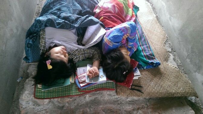 Smart, sleeping students. Mandalay, Myanmar