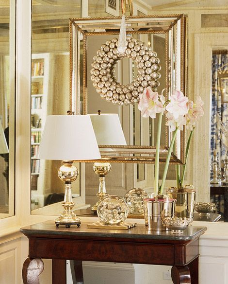Go glam with a wreath made of silver balls hanging in front of a lovely mirror  #holidayentertaining