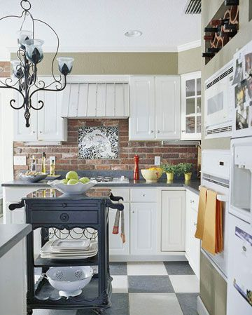 Exposed Brick Backsplash a brick backsplash, wrought-iron chandelier, & a black & white checkered floor add vintage charm!: