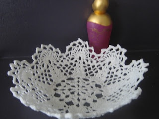 Mix 140g sugar and half a cup of boiling water, soak, wring out gently and lay to dry on a bowl you want the doily to conform to. Leave to dry for a few days (no touchy) and ta-da - you have a doily bowl ;-)