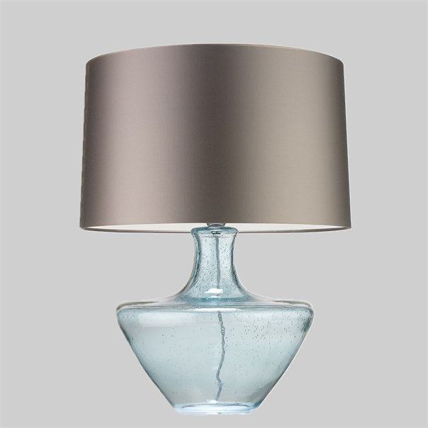 The Cicero lamp is a shapely, mould blown glass piece, showcasing a subtle organic texture, created by splashes of water. The fresh mineral tone gives this design an ethereal and sophisticated feel. This design is individually crafted and will vary from piece to piece; providing a unique and timeless product.
