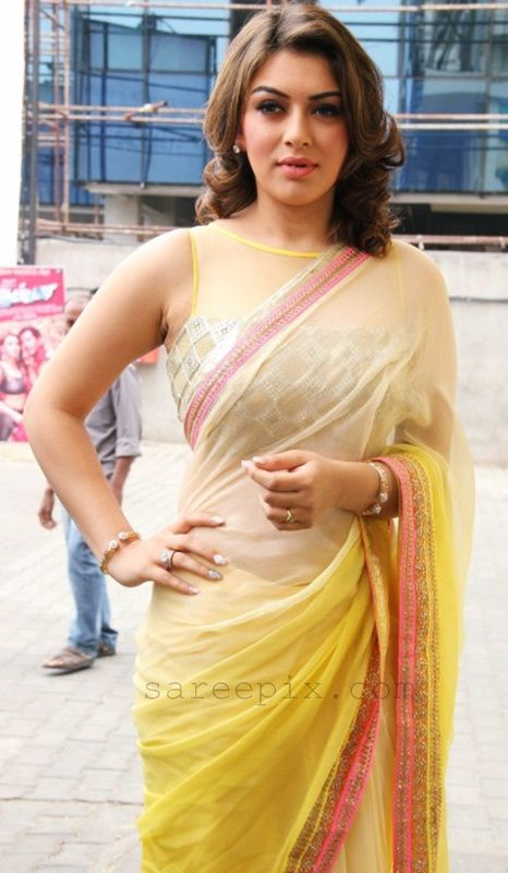 "Kollywood girl Hansika in transparent saree at ""Aambala"" tamil movie audio release function. Hansika was awesome in a yellow and cream double shaded transp"