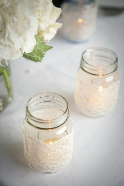 lace covered mason jars with tealight, around centerpieces. NEED: small baby food jars, mod podge, lace, flameless luminaries in tealight size.