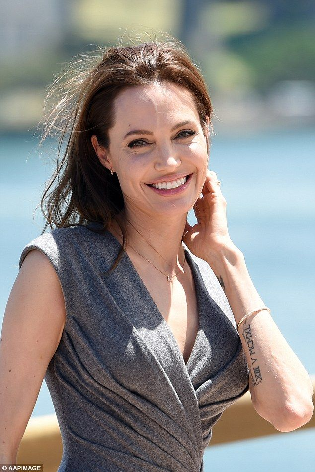 Crikey mate, she's a ripper! Angelina reveals her favourite Australian phrases 'too easy' and 'no worries' after saying she plans to return to direct in Australia again, pictured outside the Opera House on Tuesday