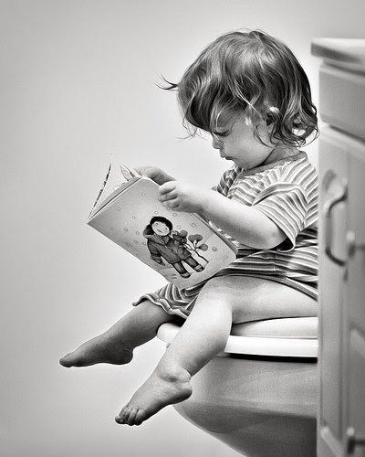 cute moment captured of a toddler boy potty training