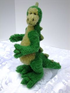 I am delighted to introduce Dino, the dinosaur. He is approximately 11inches (27cm) tall.  $85.00