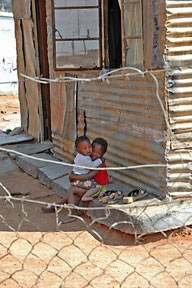 """Two kids """"sticking together"""" in a township in Cape Town"""