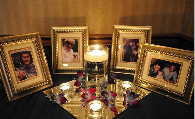For your wedding reception memorial table... matching frames (of varying sizes) + memorium candle + mirror disc... sprinkle in the tealights and flowers/petals. Keep it clean and classy and in-theme with your wedding.