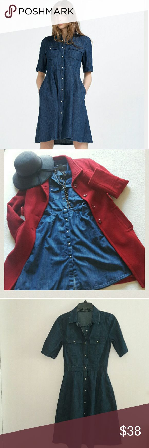 🌹Zara denim dress 🌹 Zara Basic denim dress in excellent condition  Snap buttons all the way , fit and flare style , two pockets , indigo blue color . This dress is new wit out  tag . Very cute jean dress , XS size , 100% cotton  Red coat for sale @ 55 dollars Zara Dresses Midi