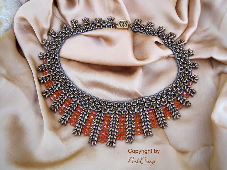 PerlDesign: Was hat Erich Kästner mit Perlenschmuck gemeinsam? Orange and gunmetal colour beaded necklace.