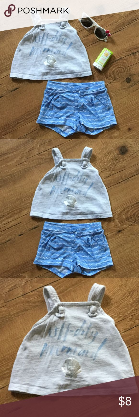 "Blue and gray mermaid shorts outfit Blue shorts with white waves, light gray tank top with criss cross straps and a tulip back. Top says ""off duty mermaid"" in blue and has a metallic sea shell underneath the writing.  Please ask any necessary questions prior to purchasing. No trades. Save even more with a bundle discount! Old Navy Matching Sets"