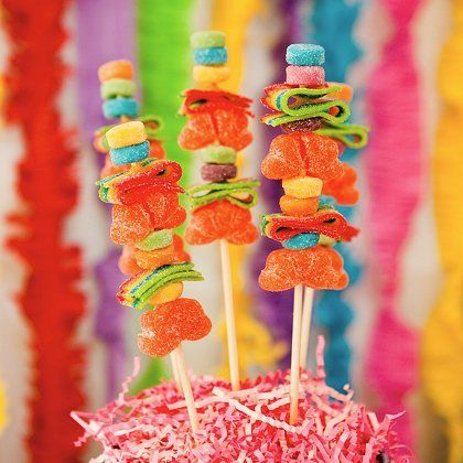 "Hawaiian Candy ""Fruit"" Skewers - a variety of gummy candies on a skewer.  So easy!  #candy #partygift #candybuffet"