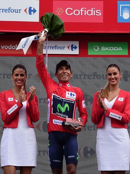 Movistar's Colombian cyclist Nairo Quintana celebrates on the podium retaining…