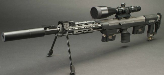 The DSR-1 sniper rifle with tactical silencer and spare magazine.