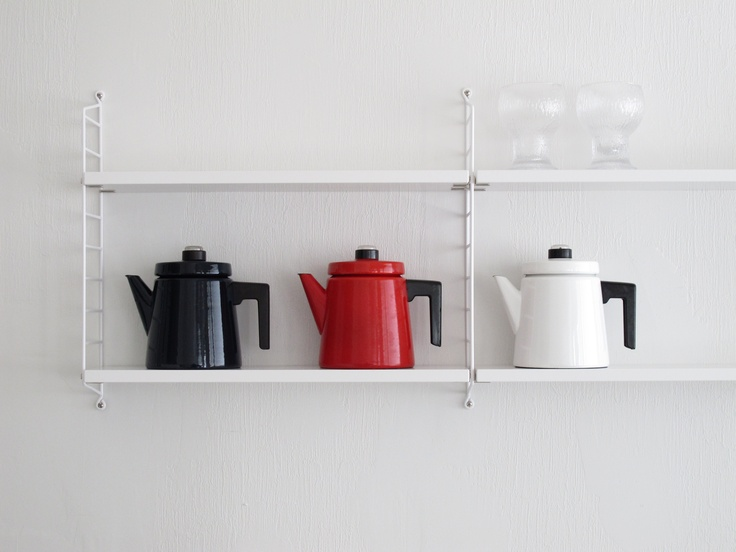 Antti Nurmesniemi Pehtoori- coffee jugs, Finnish design classics. The glasses on the top shelf are designed by Timo Sarpaneva.
