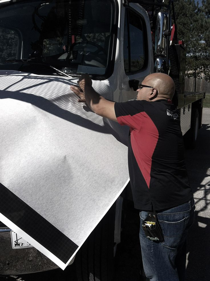 """Side Effects Graphics installs new graphic vinyl to an Elliot Crane Truck. The newest member of TekSign's fleet: """"Dorothy Ann"""" will be the first to be wrapped up with the new graphic designs."""