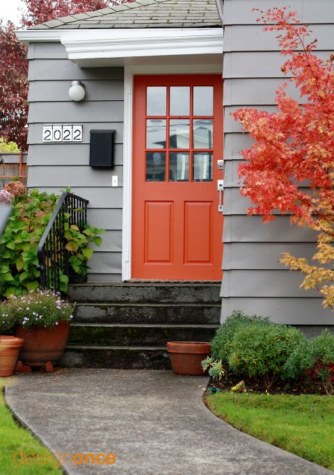 I love this entrance! Light, reddish/orange door, numbers, and gray color!