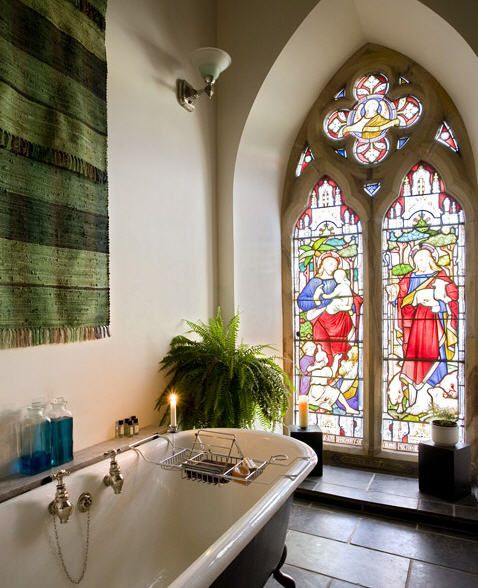 I Love this Converted Church home. Amazing stained glass windows in this bathroom! WOW!