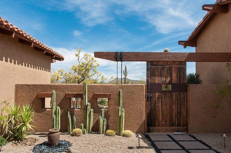 southwest landscape ideas landscape southwestern with beige stucco exterior metal path lights