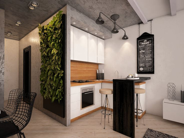 Студию с маленькой спальней удалось изменить без перепланировки: бетонные стены, балки под потолком, мебель в скандинавском стиле и пышная зелень на стенах сделали этот проект уникальным