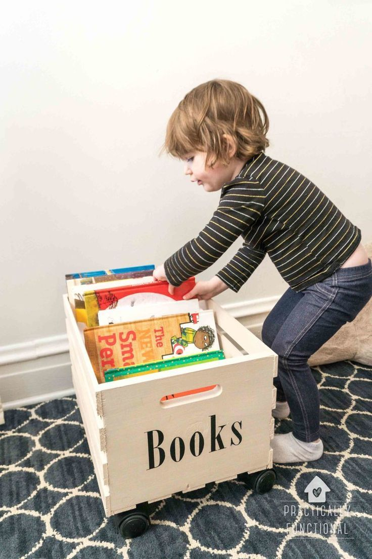 This DIY rolling crate is the solution you've been searching for! It is great for easy toy storage and mobile book storage. Learn how she made this brilliant, and super easy, DIY in less than an hour! #rollingcrate #bookstorage
