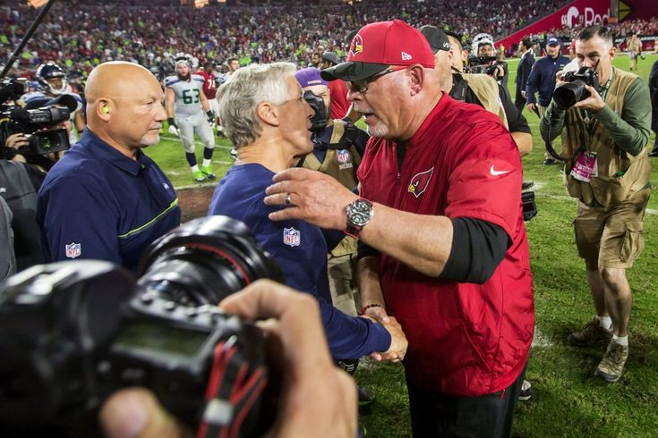 Seahawks tie the Cardinals, 6-6, in OT  -  October 23, 2016:    Seattle Seahawks head coach Pete Carroll and Arizona Cardinals head coach Bruce Arians shake hands after a tie in overtime. (Bettina Hansen / The Seattle Times)