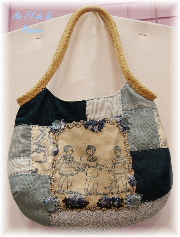 something I really like about this purse, not the color or the dark blue at least. Love the embroidery and the scrap look