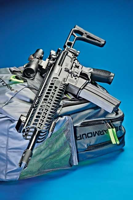 The MCX Patrol Rifle fired for this report came with a 16-inch barrel, a 30-round magazine, an 11.75-inch-long KeyMod handguard, flip-up iron sights, a SIG SAUER textured grip, and a side-folding buttstock.