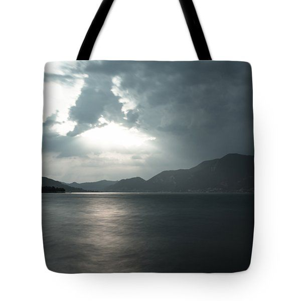 Stormy Sunset On The Lake Tote Bag by Cesare Bargiggia