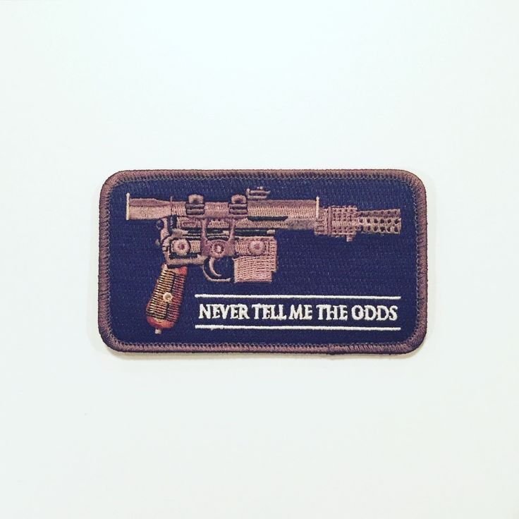 """Never Tell Me The Odds Blaster Morale Patch is High Quality 100% Embroidered 4.5"""" W X 2.5""""H Velcro with Hook and loop backing Morale Patch design by guest artist UrsusX (Patrick Ma)"""