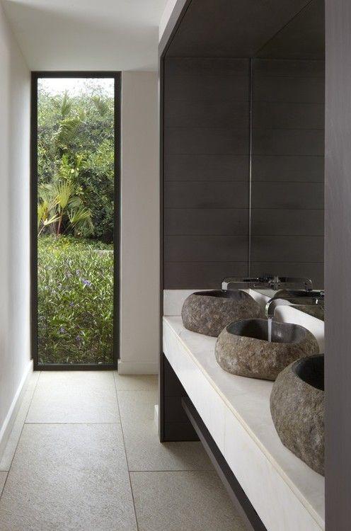 Beautiful stone basins in this sleek, minimalist bathroom