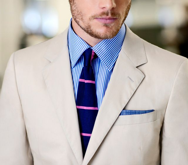 Beige jacket, white shirt with blue dress stripes, navy tie with pink stripes