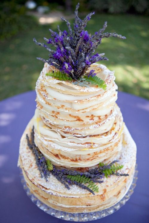 The beautiful lavender french crepe wedding cake above has been created by Petite Reve Cafe in Ventura California. The crepe wedding cakes has over 200 crepes in its construction of lavender vanilla pastry cream and can serve 60 people. Due to the delicate nature of the cakes, they are not available for shipping but transportation can be arranged.