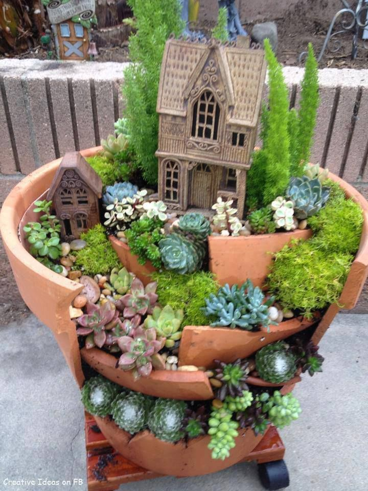 fairy garden or gnome garden idea from a broken terra cotta pot with succulents perfect for any flower garden craft club project