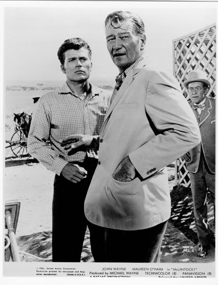 John Wayne and his son Patrick on the set of McLintock!, my favorite of his films.