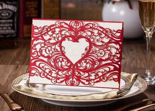 This exquisite invitation design featuring alluring red laser cut patterned details is the ideal way to announce your celebration. From engagements to weddings this stand out design will work for both