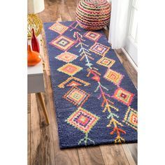 This hand-tufted wool area rug features a striking moroccan pattern. This soft a plush area rug was meticulously handcrafted to create a luxurious boldness and softness under foot.