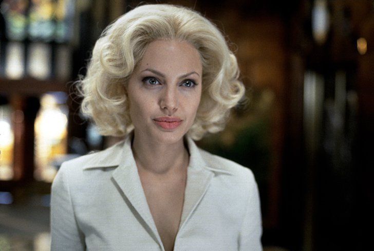Pin for Later: Look Back at Angelina Jolie's Sexiest, Most Scintillating Pictures Through the Years  The actress had blonde locks again in 2002's Life or Something Like It.