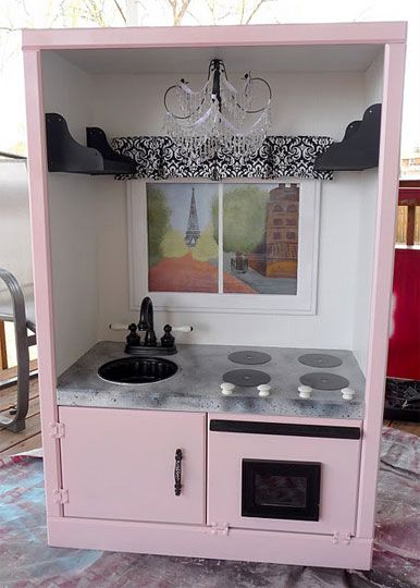 Parisian Play kitchen made from an old entertainment center.. such a cute