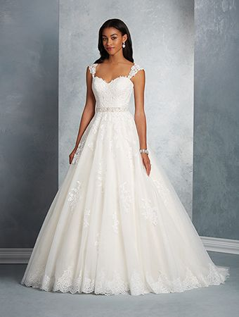 A romantic wedding dress with sweetheart neckline, detachable cap sleeves, A-line skirt, and chapel train.