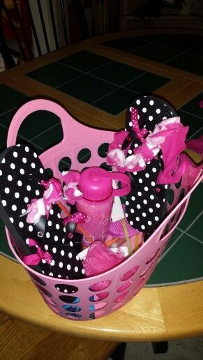 Goody basket contents: decorated flip flops, home made bath salts ...