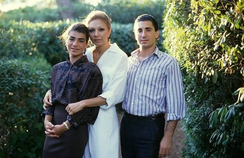 Empress Farah Pahlavi with her younger son Prince Ali Reza Pahlavi and her younger daughter ...