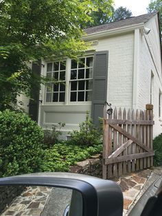Exterior paint: Benjamin Moore Floral White (brick) and Chelsea Gray (shutters)